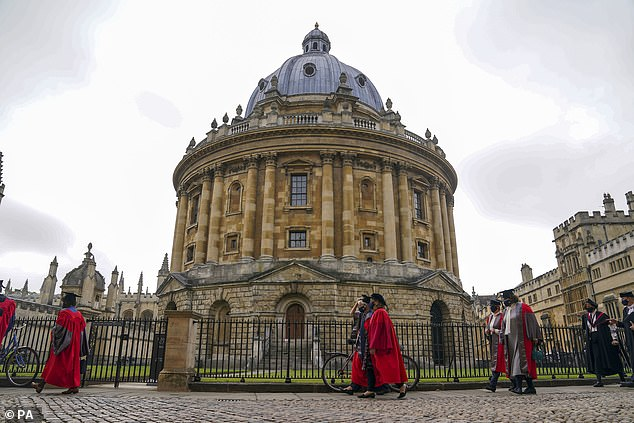 Former US Secretary of State Hillary Clinton (center right) walks in a procession through the Bodleian Library quadrangle at Oxford University