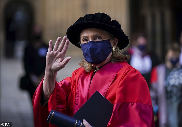 Former US Secretary of State Hillary Clinton walks in a procession through the Bodleian Library quadrangle at Oxford University, after receiving an honorary degree at the annual Encaenia Honorary Degree Ceremony