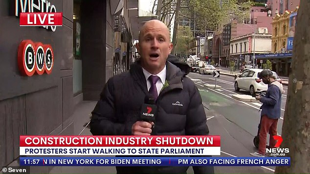 Under siege: Melbourne's recent anti-vax protests have been marred by violence, including against reporters covering the demonstrations. Pictured: Seven News reporter Paul Dowsley