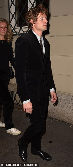 Fashion pack: Nikolai, 34 looked dapper in a jet black suit which he teamed with a white shirt and green tied