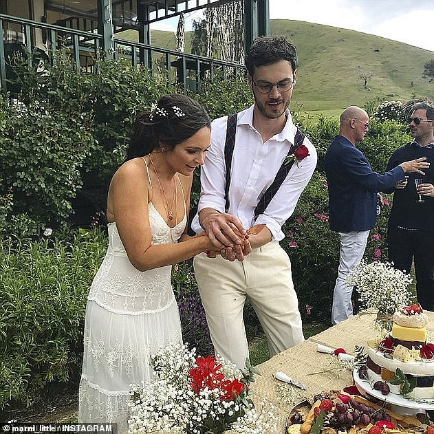 Tying the knot: Dan and Marni were married from2012 to2016. The comedy writer remarried David (right)in October 2018. They are pictured cutting the cake on their wedding day