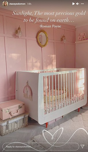 Lovely: Stacy shows off beautiful bedroom with white crib, vintage-style mirror and suitcase