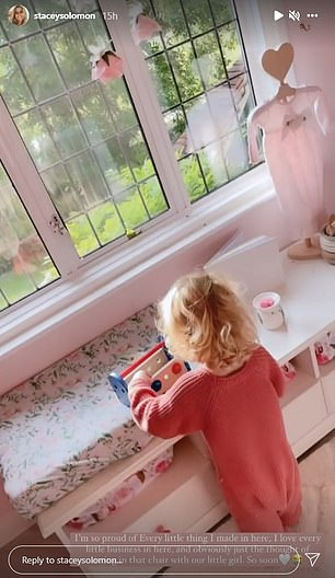 Cute: Then she took to her stories once again to film her little girl's futuristic pink and flower bedroom, with Rex sweetly playing in the background