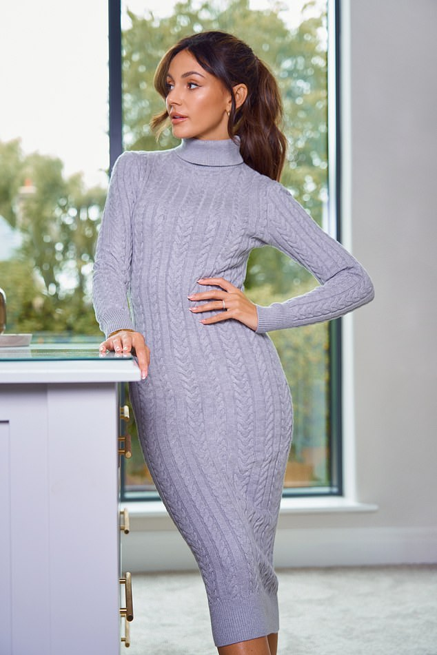 Looks great: Michelle Keegan showed off her figure in a lilac knit dress as she modeled a selection of comfy fall looks from her latest very stylish clothing line on Monday