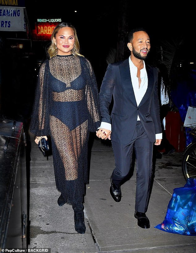 Back in Black: Later, the Vogue favorite wore a see-through black outfit that left little to the imagination as she dined with John after Tonys.  The model, 35, took a look at her underwear in a sheer, racy black dress as she arrived at the fancy restaurant with her beau, 42.
