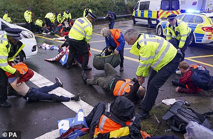 Police officers today arrested protesters from Insulate Britain at a crossroads leading from the M25 to Heathrow Airport