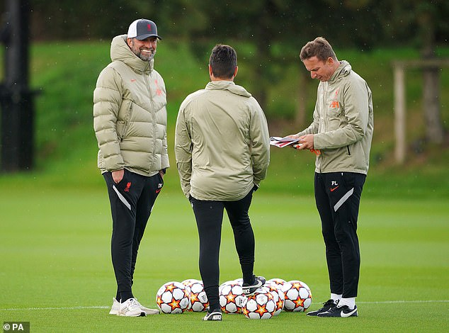 Jurgen Klopp (left) has turned down any suggestions Liverpool for Porto.  against it would be easy