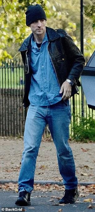 Make way: George was seen walking towards a waiting car