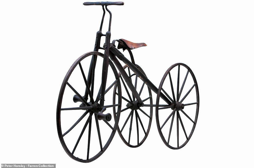 This Child's Wood Boneshaker Tricycle was made by Chicago-based Marble and Schoeniger in 1876 and boasted wooden forks and frame. However, Mr Farren said that the distance of just 11 inches between the rear wheels 'makes this an extremely unstable and unsafe machine'