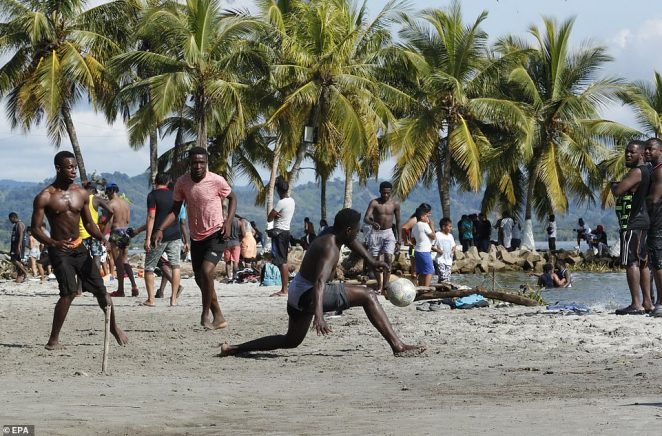 Haitian migrants play soccer as they camp on a beach in Necocli, Colombia on September 26