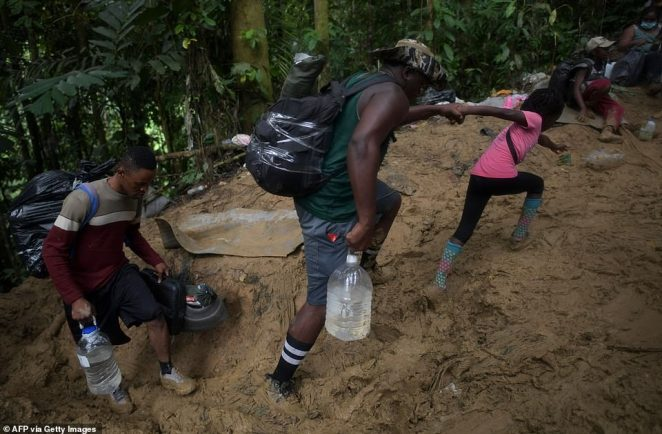 Haitians are attempting to reach the U.S. even after 12 deportation flights returned some of the new arrivals to Haiti. Pictured: Haitian migrants cross the jungle of the Darien Gap, near Acandi, Colombia en route to Panama on Sunday