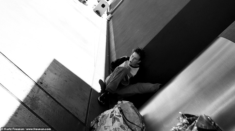 Suffering: The person was sitting in the shade on the side of a building while Frausun was snapping photos