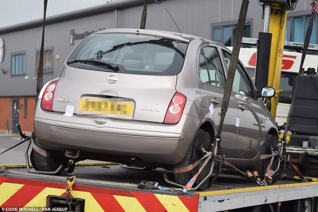 A light-coloured Nissan Micra was seized in a residential street