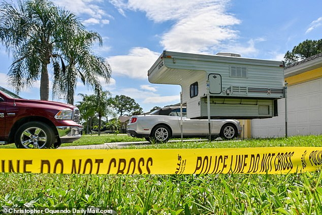 FBI agents paid another visit to the home of his parents to retrieve 'personal items' - for DNA matching - Laundrie's mom Roberta, 55, was seen darting outside at 10am to leave an item in the screened porch of their North Port, Florida home