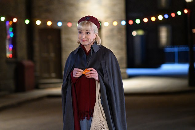 Exciting: The BBC has released the first pictures of the upcoming Call the Midwife Christmas special, in which Helen George's nurse Trixie Franklin is seen cheering for the festivities