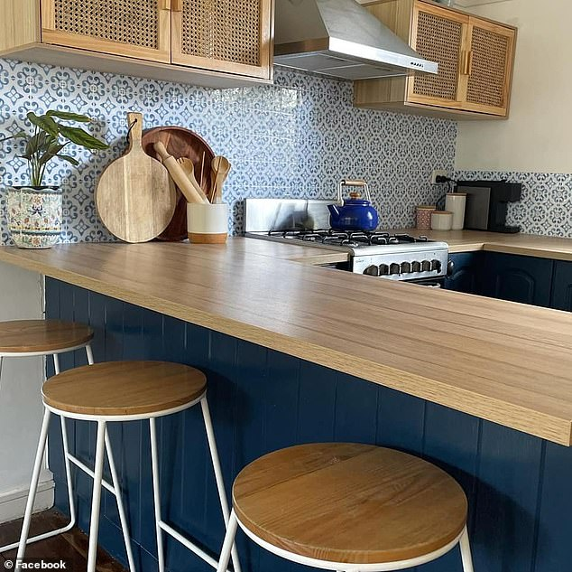 To renovate her kitchen without spending a fortune, she used $59 rattan sideboards from Kmart as cabinets for storing pantry items and cookware