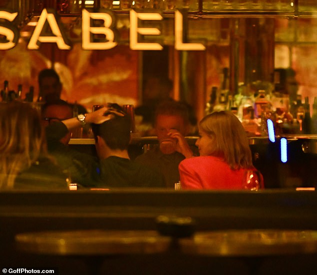 Snug: The 40-year-old Oscar-winning actor and his 27-year-old girlfriend, who have been dating since 2018, cosied up in a booth at the upmarket eatery Isabel