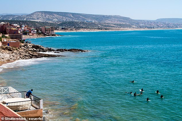 Surfers waiting for the next wave in Taghazout. The bay first became popular with surfers in the Sixties, Tamara reveals