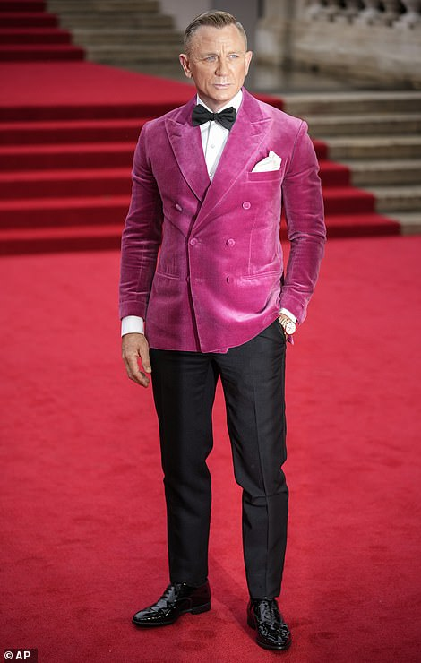 Leading man: Dapper Daniel Craig opted for a deep pink dinner jacket with dress trousers for the premiere