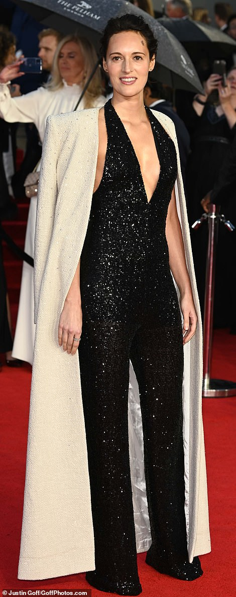 Phoebe Waller-Bridge played with contrast in a black disco jumpsuit and cream coat