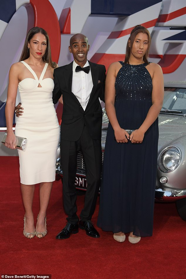 Dressed to impress:The Olympian, 38, cut a suave figure in a black tuxedo as he posed with his glamorous family on the red carpet of the star-studded event