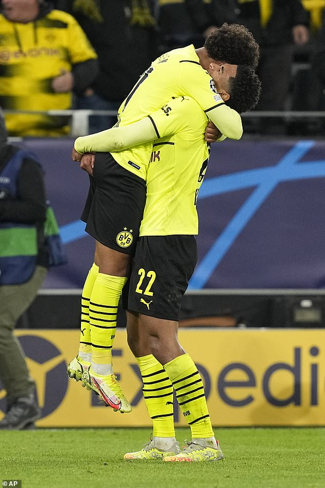 Dortmund's Malen, left, celebrates with team-mate Bellingham after scoring in the first-half