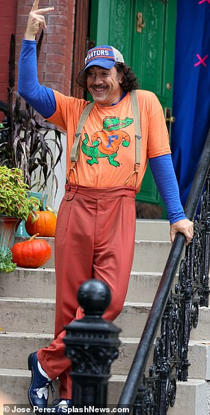 Vibrant:Bardem meant business wearing a pair of rusty red trousers with brown leather suspenders attached to his hips