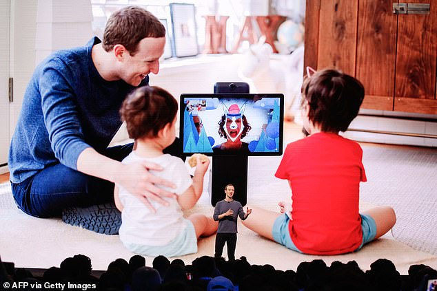 Mark Zuckerberg is seen in April 2019 speaking atthe Facebook F8 Conference at McEnery Convention Center in San Jose, and describing new features on their products which are designed to keep children safe
