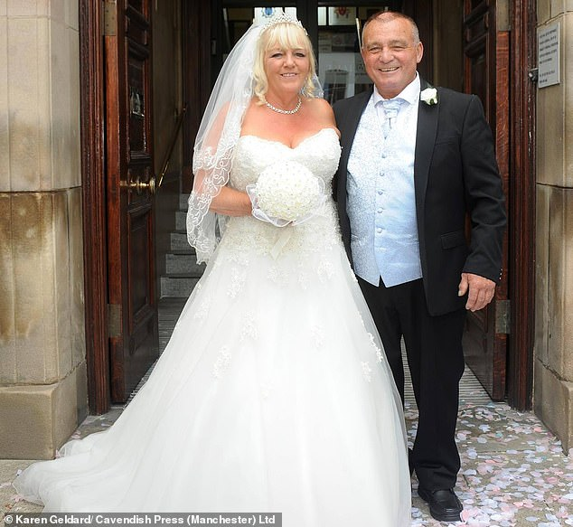 Tony Geldard (pictured with his wife Karen on their wedding day in 2016), 63, slipped and fell eight feet to the ground while working on top of the snug, landing on a set of scaffolding boards and horizontal poles below