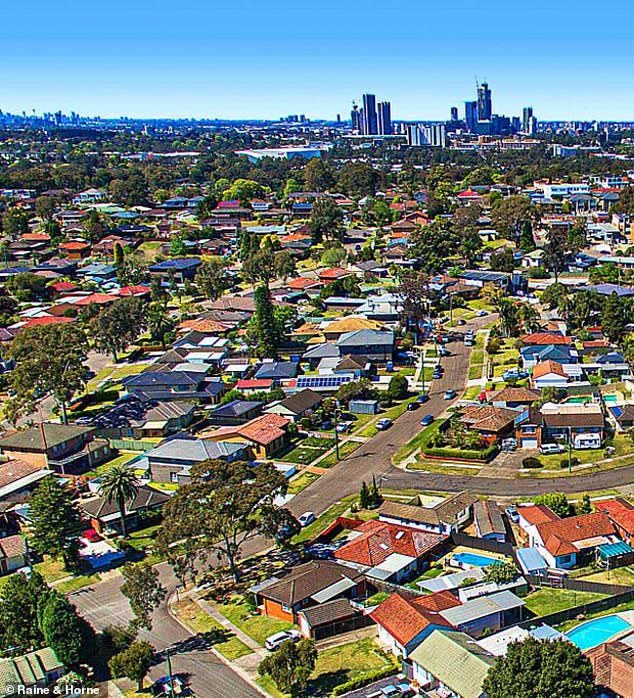 Australians on average salaries could soon struggle to get home loan approval to buy a house in Sydney or Melbourne under a mortgage crackdown. Houses in Australia's two biggest cities are typically selling for more than $1million which would put them out of reach for a potential borrower earning an average, full-time salary of $90,329 (pictured is Constitution Hill in Sydney's west)