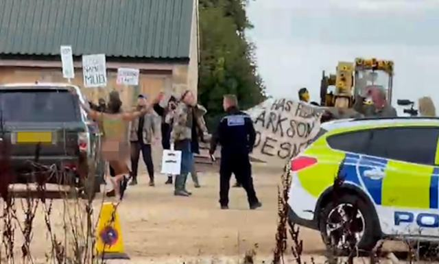 In chaotic scenes that fooled locals, one of the protestors was naked and ran around the site in a Monty Python style as police chased after him