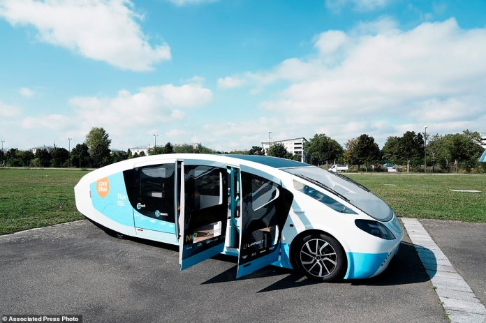 A solar-powered vehicle is on display on a closed street in Guanacourt, south of Paris.  The Solar Team is the creation of a group of students at Eindhoven, a team of about 20 enthusiastic and ambitious students at the Eindhoven University of Technology in the Netherlands.