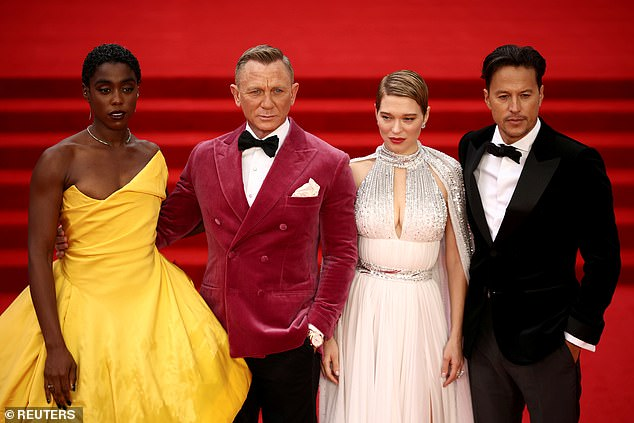 Lashana Lynch, Daniel Craig, Lea Seydoux and director Cary Fukunaga pose during the world premiere of the new James Bond film No Time To Die at the Royal Albert Hall