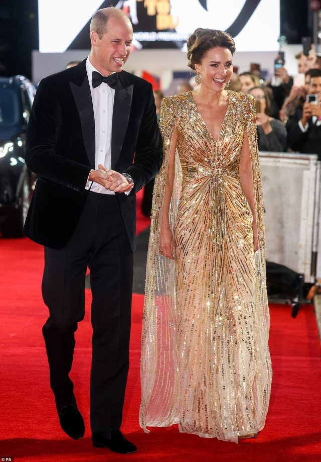 The Duke and Duchess of Cambridge arrive for the premiere of No Time To Die at the Royal Albert Hall in London on Tuesday. Sequinned and resplendent Kate swept down the red carpet in jaw dropping fashion