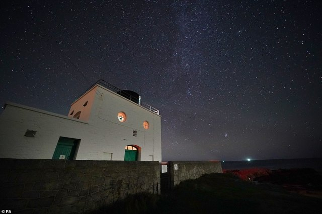 On Thursday morning, the Milky Way was seen during a stunningly clear night over Bamburgh Lighthouse in Northumberland
