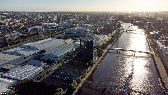 Friday will see early outbreaks of heavy rain in the south-east before a mix of scattered showers and sunny spells throughout the country for the rest of the day: Pictured: Glasgow in the sun on Wednesday