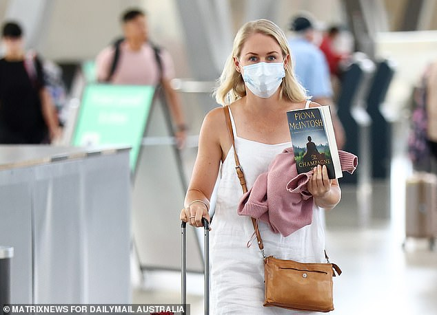 NSW will not enforce any quarantine at all on vaccinated arrivals from November 1. Pictured: Sydney Airport in December
