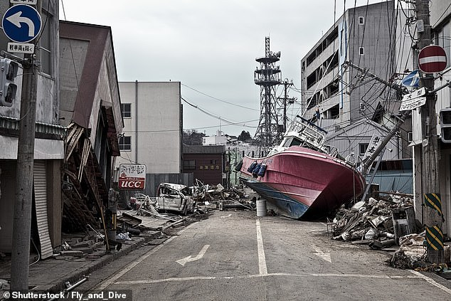 The incident, which saw homes destroyed (pictured), 20,000 killed and 100,000 children uprooted from their homes, may also have contributed to cognitive decline in older adults.