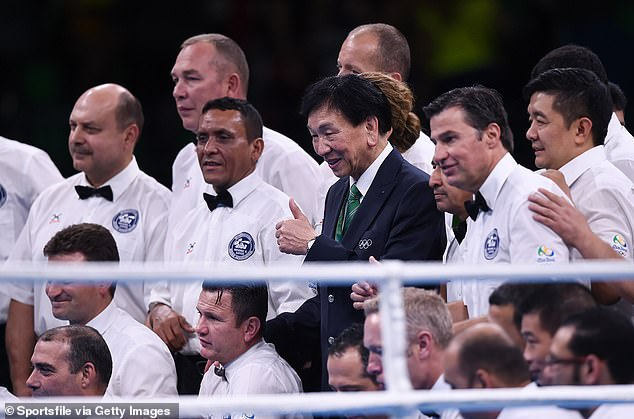 AIBA former president Dr Ching-Kuo Wu with referees and judges following the final boxing session at the Rio Olympic Games in 2016 - the AIBA subsequently commissioned an inquiry
