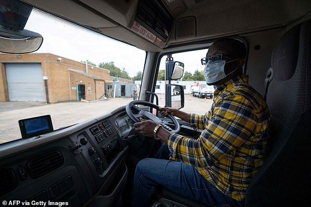 A learner lorry driver as he prepares to reverse an HGV at a centre in Croydon
