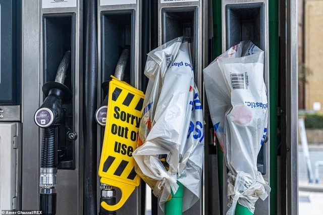 Petrol nozzles are covered at an Esso filling station in Wimbledon, South West London as the fuel supply crisis continues