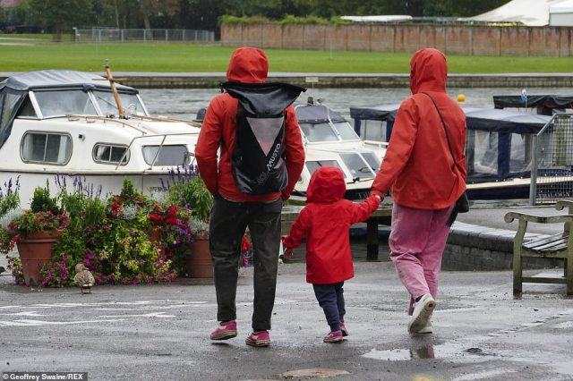 People out for a Saturday morning walk in Henley-upon-Thames were forced to wrap up well with threatened rain