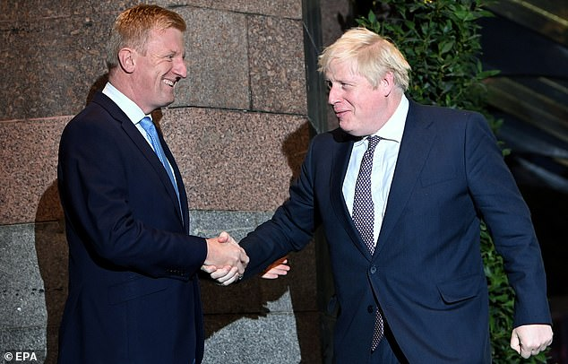 Johnson was greeted at the Midland Hotel by new party chairman Oliver Dowden, and entered without answering questions from reporters