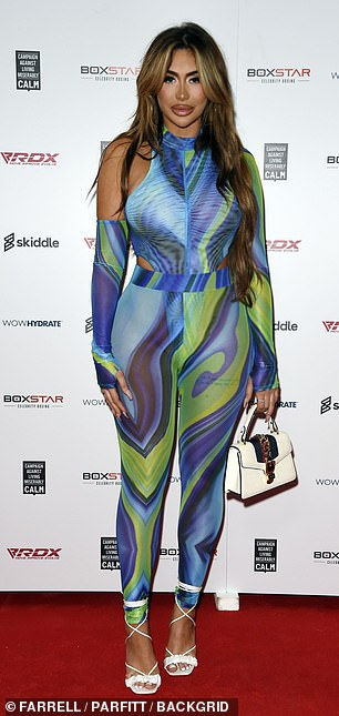 LOOKING GOOD: Chloe Ferry, 26, grabbed attention in a flashy green and blue patterned jumpsuit