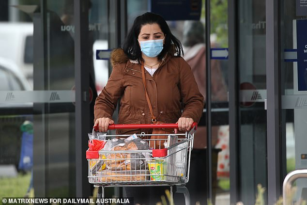 Victoria has recorded 1,220 new Covid-19 cases and three deaths overnight (pictured, a woman shopping in Melbourne)
