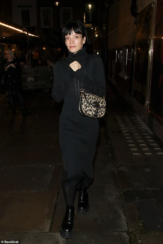Style: Lily Allen cut a chic figure in a high-neck black midi dress after running the boards at 2:22 A Ghost Story at the Noel Coward Theater in London's West End on Saturday.