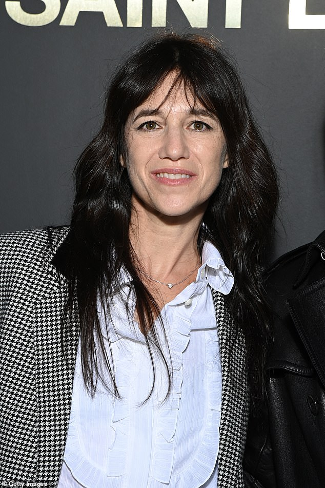 Charlotte Gainsbourg, 50, pictured during Paris Fashion Week this year, says her mother Jane Birkin's approach to aging is 'inspirational' and hopes she has the 'courage' to age naturally