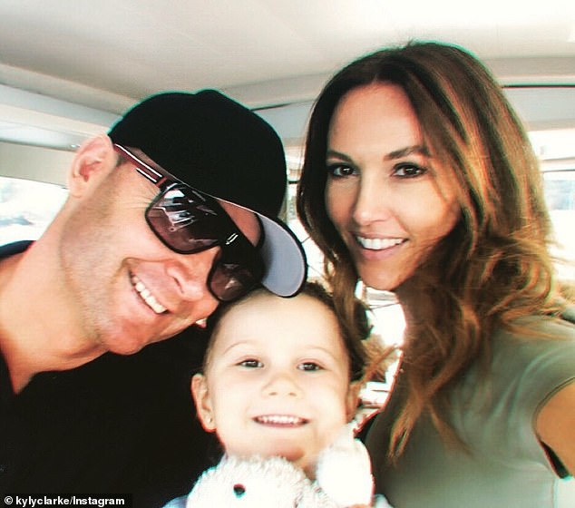 Moving on: Michael and ex-wife Kyly (right) kept their separation quiet for several months before she put a statement on instagram saying their priority was their daughter, Kelsey Lee (centre)