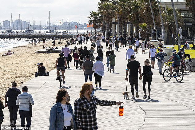 Health officials have responded to the burgeoning outbreak of new infections in the city's southeast by opening pop-up vaccination clinics in the area (pictured, people in St Kilda)