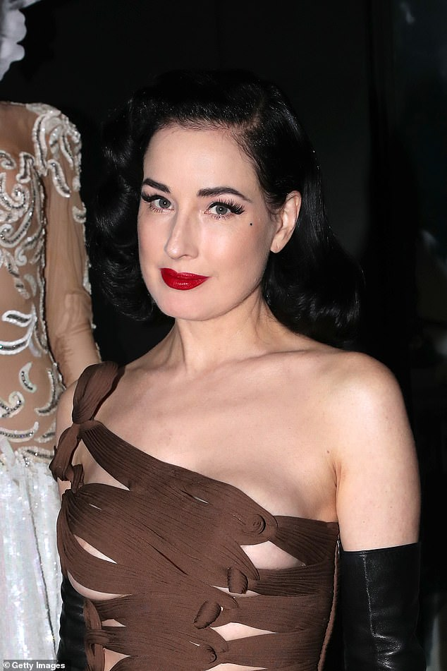 The Beauty: Infused with 1950s glamour, she dyed her pout an eye-catching shade of cherry red and accentuated her lashes with extensions for a dazzling event